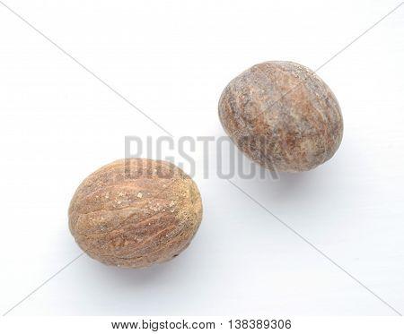 Nutmeg isolated on white background Myristica fragrans