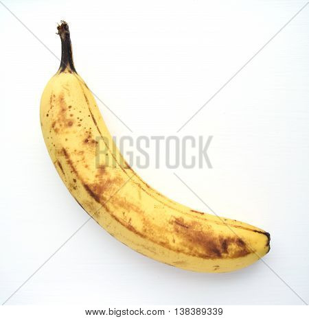 Overripe banana ready to eat isolated on white background