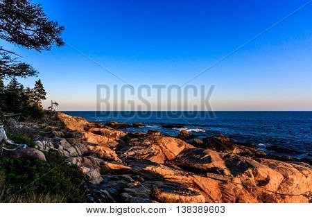 The rocky coast of Main during sunset in Acadia National Park