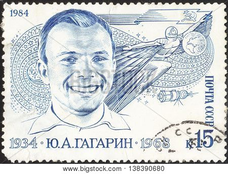 MOSCOW RUSSIA - DECEMBER 2015: a stamp printed in the USSR shows portrait of famous Soviet pilot and cosmonaut Yuri Gagarin devoted to the 50th Anniversary of the Birth of Yuri Gagarin circa 1984