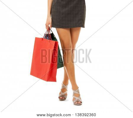 people, sale and consumerism concept - close up of woman with shopping bags over white background