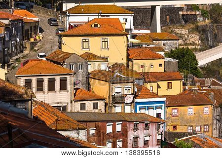 PORTO, PORTUGAL - NOV 12, 2016: View of houses Old District near the Douro river in the historic centre of City. Porto won the European Best Destination 2012 and 2014 awards.