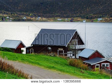 Horizontal Vivid Norway House On The Bank Of The River Landscape