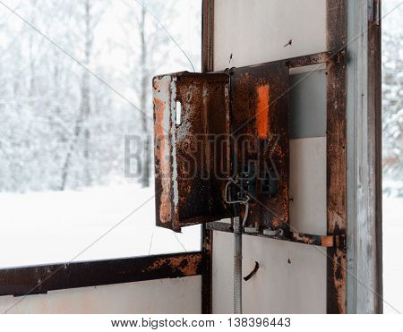 Horizontal rusty cyberpunk public call-box winter bokeh background backdrop