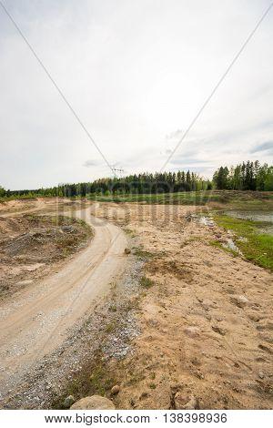 Sand pit / quarry. Summer landscape. Man made nature.