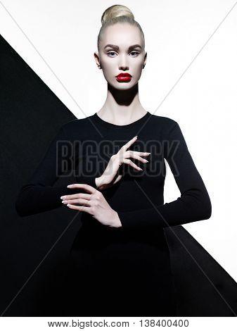 Fashion art studio portrait of elegant blode in geometric black and white background