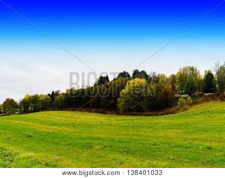 Horizontal danish field hills with blue sky background backdrop