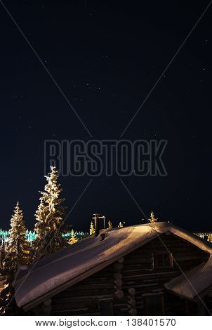 Vertical Finnish house at night with stars background backdrop