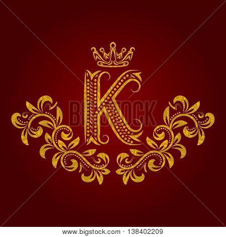 Patterned golden letter K monogram in vintage style. Heraldic coat of arms. Baroque logo template.