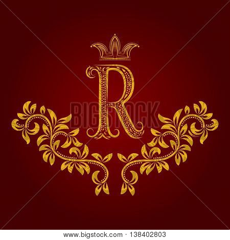 Patterned golden letter R monogram in vintage style. Heraldic coat of arms. Baroque logo template.