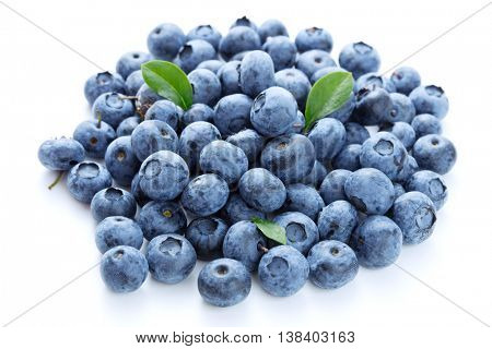 Blueberries with leaves on white background