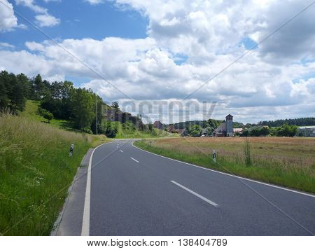 Asphalted Road In The Countryside Landscape