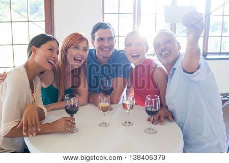 Friends taking a selfie at restaurant