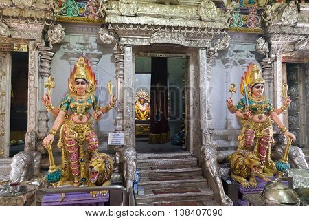 Singapore, Singapore - January 31, 2015: Statues at the entrance to the Hindu temple in the district Little India.