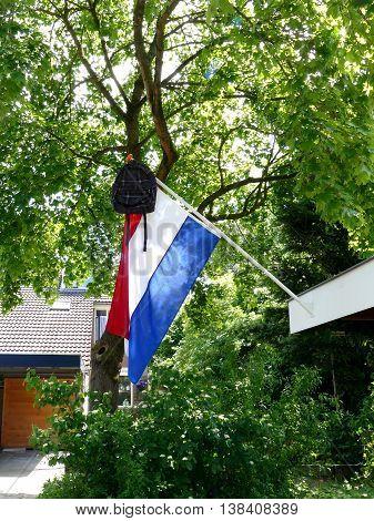 Dutch tradition school bag on flag when graduating