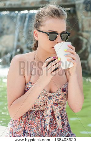 Girl Drinking Coffee Outside From Takeaway Cup