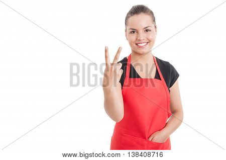 Beautiful Young Saleswoman On Hypermarket Counting Two