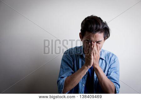 man wear denim shirt and look uhappyisolated white backgroundasian