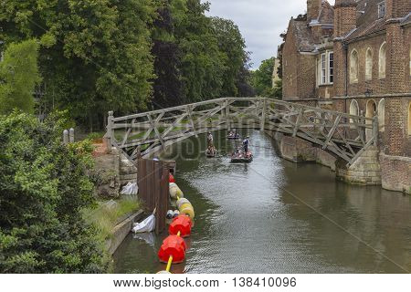 Cambridge England - July 7 2016: Tourists boating on traditional punt boats over the river in Cambridge England.