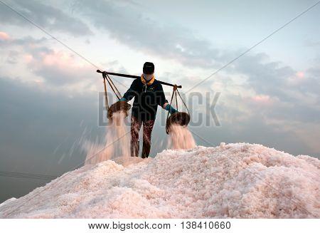 Khanh Hoa, Vietnam, August 3, 2015 farmers groups, Hon Khoi, Khanh Hoa province, harvesting salt products.