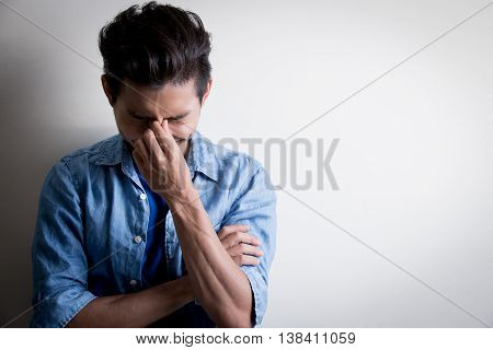handsome man wear denim shirt and look happily isolated white background asian