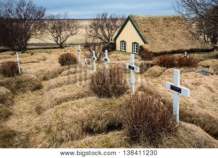 HOF ICELAND - MARCH 27: Crosses at the Cemetery of the Famous Hofskirkja turf church at Hof place in Southeast Iceland on Hof Iceland, March 27 2016