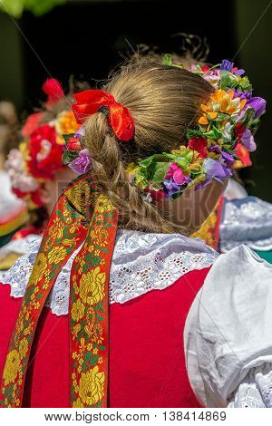 Detail of Polish folk costume for woman with multi colored embroidery.