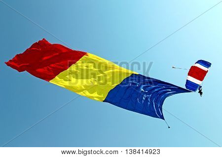 TIMISOARA ROMANIA - JULY 18 2015: Parachutist with the romanian flag at Air Show organized by the international airport from Timisoara.
