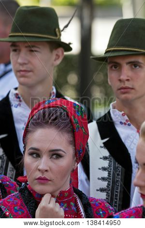 ROMANIA TIMISOARA - JULY 7 2016:Woman and men from Romania in traditional costume present at the international folk festival