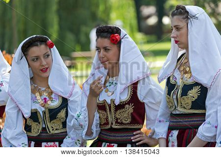 ROMANIA TIMISOARA - JULY 10 2016: Young girls from Serbia in traditional costume present at the international folk festival