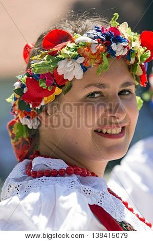 ROMANIA TIMISOARA - JULY 10 2016: Young girl from Poland in traditional costume present at the international folk festival
