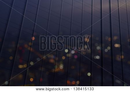 Reflect of blur aerial view of cityscape with warm light sundown