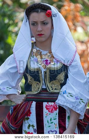 ROMANIA TIMISOARA - JULY 10 2016: Young girl from Serbia in traditional costume present at the international folk festival
