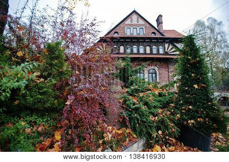 Autumn yard of old gothic mansion outdoor