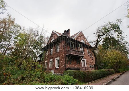 Old Abandoned Brick  Mystic Mansion. Gothic Building At Autumn