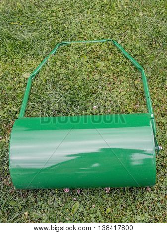 Green lawn roller on the grass