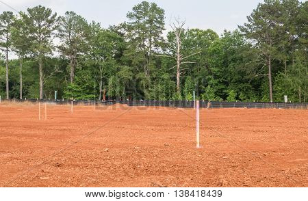 A Residential Lot Staked Out in Dirt