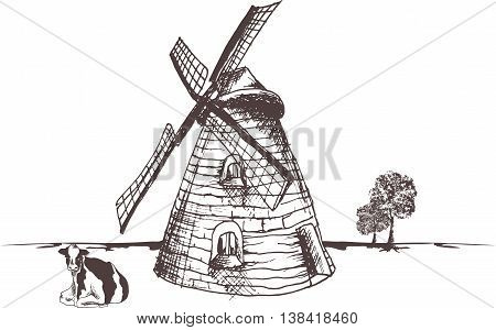 Rustic wind mill with blades. Cow sitting on the ground.