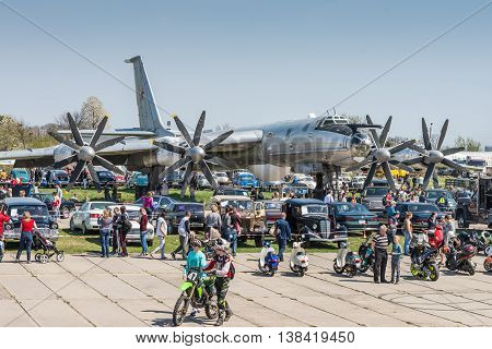 Kyiv Ukraine - April 26 2015: Strategic bomber Tu-95 Bear is in the State Museum of Aviation.People walk viewing the exhibits of the festival