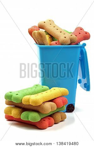 blue bin full of dog bones with a stack of coloured dog treats