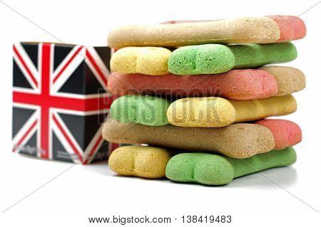 british box and a stack of coloured dog treats