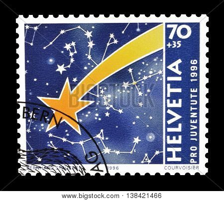 SWITZERLAND - CIRCA 1996 : Cancelled postage stamp printed by Switzerland, that shows Comet and cosmos.