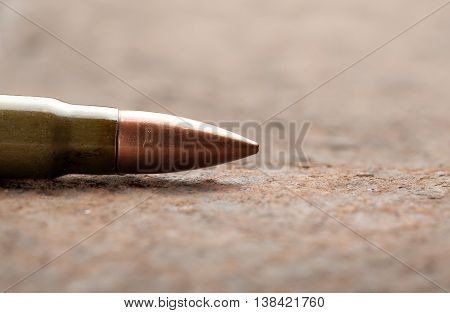 Bullet On Rusted Metal Background