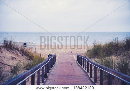 path to North sea beach in purple sunset sunshine, North Holland, Netherlands