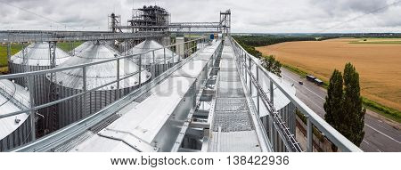 Towers of grain drying enterprise. metal grain facility with silos
