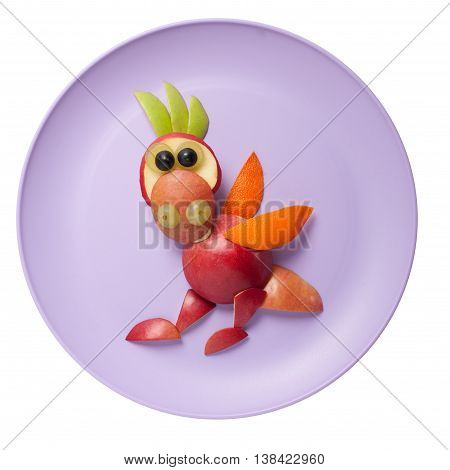 Funny dragon made of fruits on pink plate
