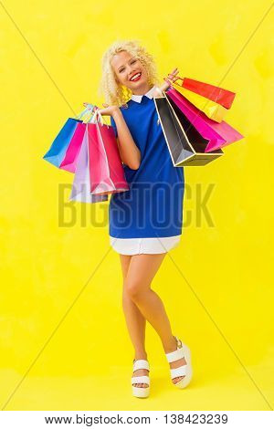 Stylish woman holding shopping baqgs after shopping