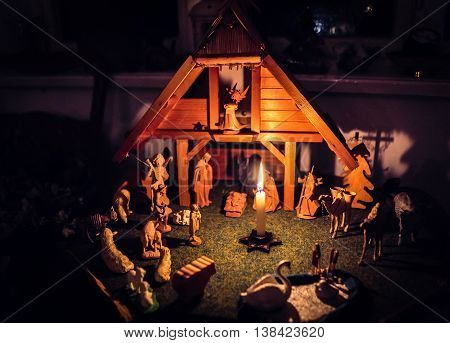 nativity scene with wooden figures for advent and christmas time