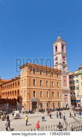 NICE FRANCE - APRIL 11 2016: Rusca Palace (1780) with Clock Tower (1718) at Palais Square in Nice. Originally built as barracks was converted into an annex of the Palace of Justice in the 1990s
