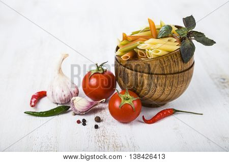 Raw Pasta And Spices In Wooden Bowls